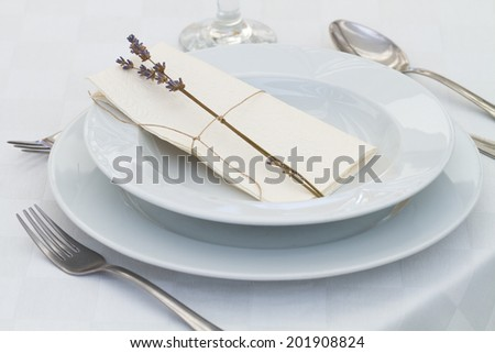 dining table setting with lavender - stock photo