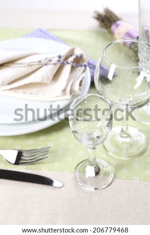 Dining table setting with lavender flowers on table background - stock photo