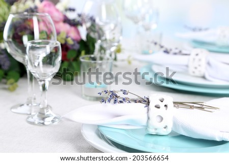 Dining table setting with lavender flowers on table, close-up. Lavender wedding concept - stock photo