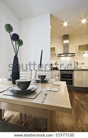 dining table setup and modern kitchen view - stock photo