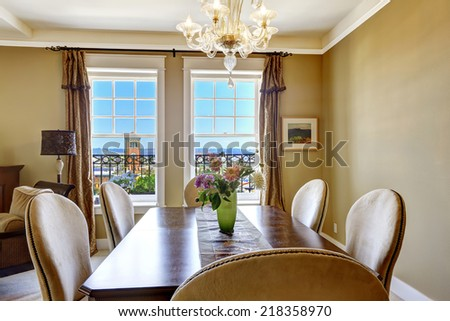 Dining table with flowers and city view through the window. Tacoma real estate, WA