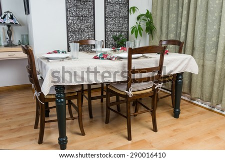 Dining table with table settings - stock photo