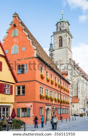 DINKELSBUEHL, GERMANY - SEPTEMBER 27: People in the old town of Dinkelsbuehl, Germany on September 27, 2015. It is one of the best preserved medieaval towns in Germany.  - stock photo