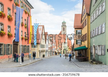 DINKELSBUEHL, GERMANY - SEPTEMBER 27: Tourists in the old town of Dinkelsbuehl, Germany on September 27, 2015. It is one of the best preserved medieaval towns in Germany.
