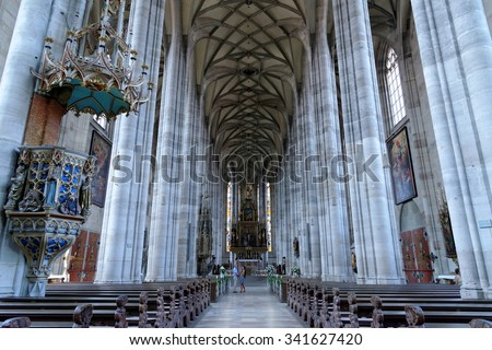 DINKELSBUHL, GERMANY - AUGUST 10, 2015: The interior of the Church of St. George in Dinkelsbuhl, Bavaria. It is a masterpiece in the Gothic style of the late 15th century by Nikolaus Eseler.