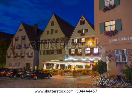 Dinkelsbuhl, Germany - July 27, 2015: Dinkelsbuhl is one of the archetypal towns on the German Romantic Road. Street view by summer night.