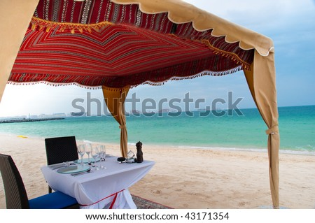 Dinner at the Beach in Dubai - stock photo