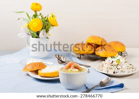 Dinner background. Leek cream soup, chicken salad and carrot buns. selective focus - stock photo