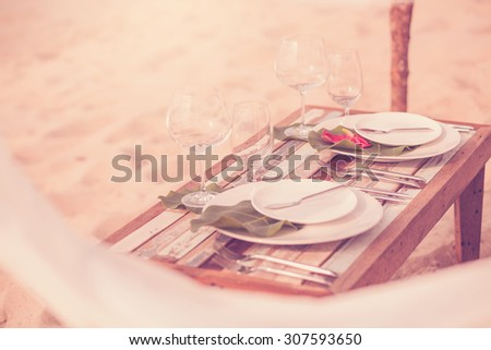 Dinner for two on the beach, a meeting or wedding. sunset, table - stock photo