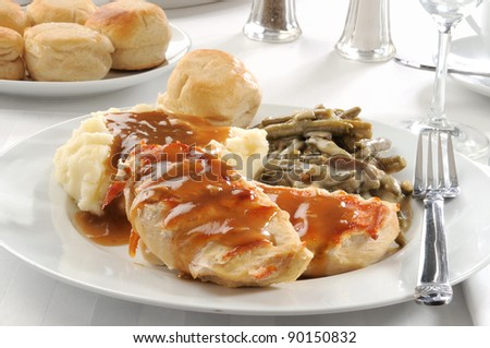 Dinner of grilled chicken breasts with mushroom gravy - stock photo