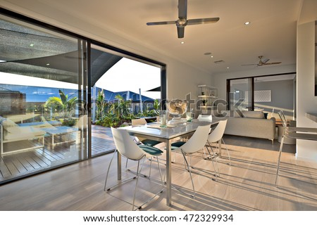Dinner On The Wooden Floor With A Glass Door Entrance Beside Chairs And Tables Near