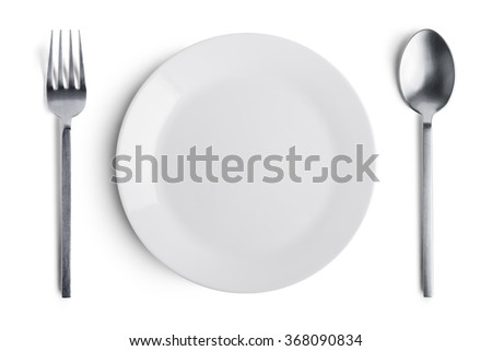 Dinner place setting. A white plate with silver fork and spoon isolated on white background. - stock photo