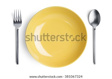 Dinner place setting. A yellow plate with silver fork and spoon isolated on white background. - stock photo
