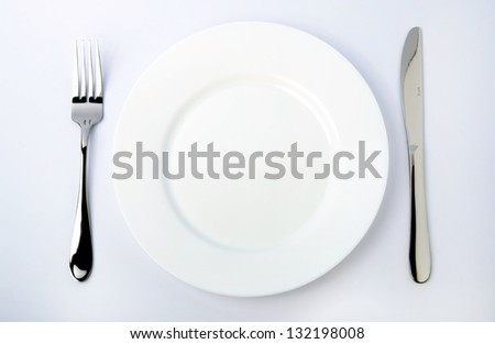 Dinner Plate, Knife, and Fork - stock photo