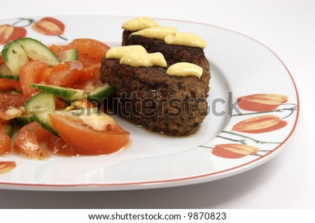 Dinner plate with kebab and vegetables on white background