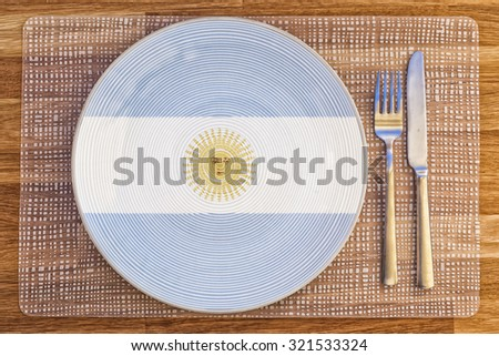 Dinner plate with the flag of Argentina on it for your international food and drink concepts. - stock photo