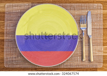 Dinner plate with the flag of Colombia on it for your international food and drink concepts. - stock photo