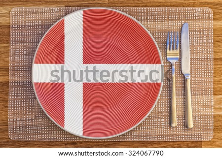 Dinner plate with the flag of Denmark on it for your international food and drink concepts. - stock photo