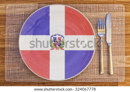 Dinner plate with the flag of Dominican Republic on it for your international food and drink concepts. - stock photo