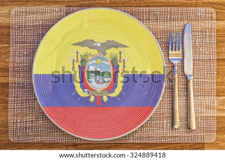 Dinner plate with the flag of Ecuador on it for your international food and drink concepts. - stock photo