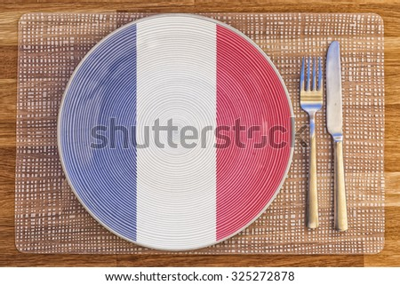 Dinner plate with the flag of France on it for your international food and drink concepts.