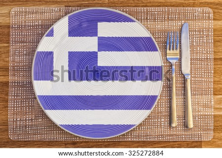 Dinner plate with the flag of Greece on it for your international food and drink concepts. - stock photo