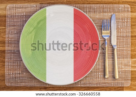 Dinner plate with the flag of Italy on it for your international food and drink concepts. - stock photo