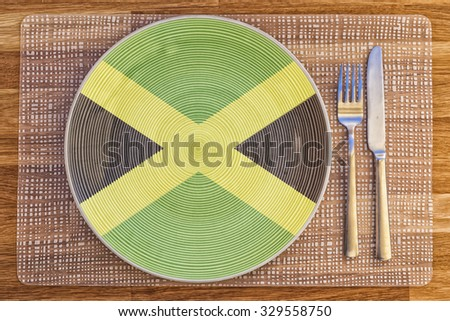 Dinner plate with the flag of Jamaica on it for your international food and drink concepts. - stock photo