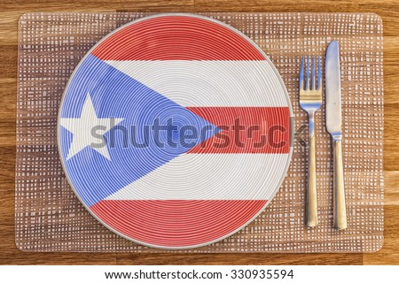 Dinner plate with the flag of Puerto Rico on it for your international food and drink concepts. - stock photo