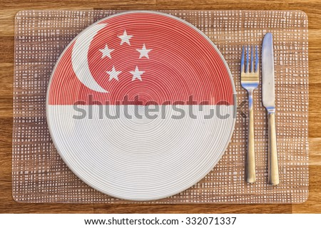 Dinner plate with the flag of Singapore on it for your international food and drink concepts.