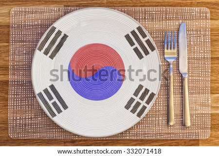 Dinner plate with the flag of South Korea on it for your international food and drink concepts. - stock photo