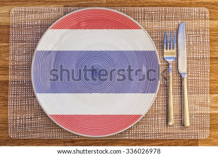 Dinner plate with the flag of Thailand on it for your international food and drink concepts. - stock photo