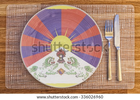 Dinner plate with the flag of Tibet on it for your international food and drink concepts. - stock photo