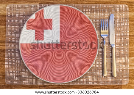 Dinner plate with the flag of Tonga on it for your international food and drink concepts. - stock photo