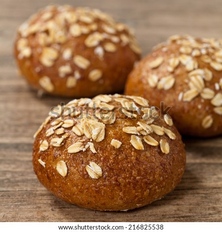 Dinner rolls with oat flakes - stock photo