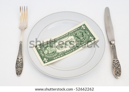 Dinner service with dollar denomination on plate.