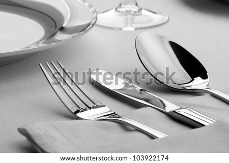 Dinner set. Fork, knife and spoon on the table - stock photo