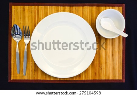 dinner set on the bamboo mat - stock photo