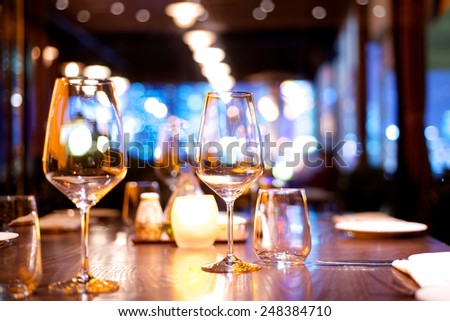 Dinner table set up in a restaurant - stock photo