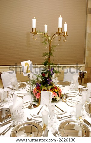 Dinner table setting at a banquet with flowers on a chandelier 3 - stock photo