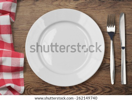 dinner table with dinning plate, fork and knife top view - stock photo