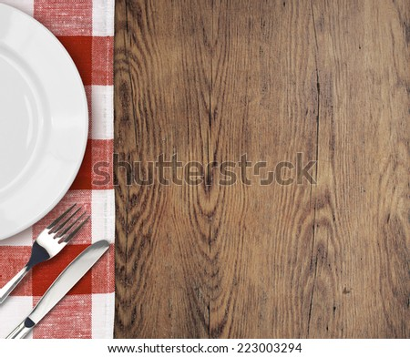dinner table with setting plate top view and cutlery - stock photo