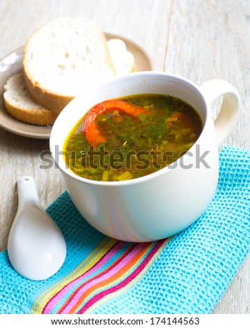 Dinner time, vegetable soup with pepper on the table
