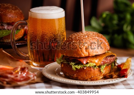 dinner with burger and beer - stock photo