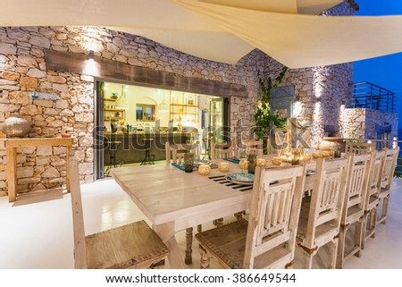 dinning area with big table in a private summer resort