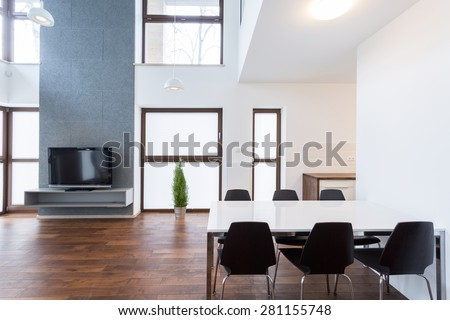 Dinning room connected with living room in contemporary property - stock photo