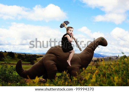 Dinosaur and Cave-boy's dreamy adventure - stock photo