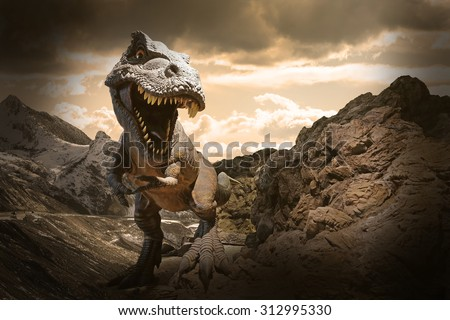 Dinosaurs model on rock mountain background - stock photo