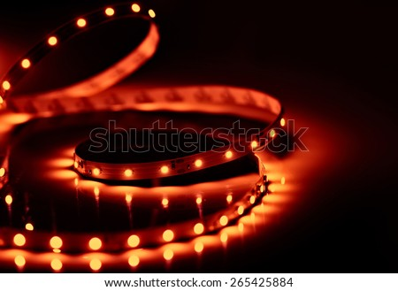 Diode led strip background. Orange color shining led crystals. - stock photo
