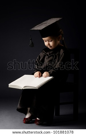Diploma graduating little student kid with book - stock photo